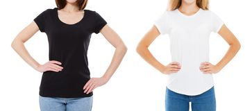 T-shirt design and people concept - close up of young two woman in shirt blank black and white tshirt isolated. Girl t shirt set. T-shirt design and people royalty free stock photos