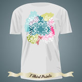 T-shirt design with white exotic ornate cross on the colorful sp Stock Photos