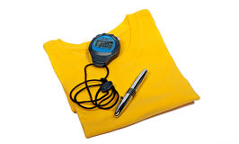 T shirt, digital stop watch and ballpoint pen Royalty Free Stock Images