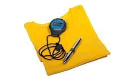 T-Shirt, digitale Stoppuhr und Ballpointfeder Lizenzfreie Stockbilder
