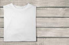 T-Shirt. Folded White Shirt Blank Textile template Stock Image
