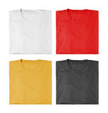 Four t-shirts folded Royalty Free Stock Photo