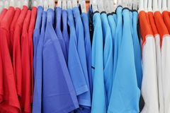 T-Shirt. Hanging Red, Purple, Blue and White T-Shirt Stock Photography
