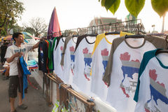 T-shirt with a map of Thailand. BANGKOK, THAILAND - December 13, 2014: Man 40-45 years selling T-shirts with a picture map of Thailand outside Bangkok. Clothes stock photo
