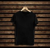 T-shirt mockup and template on wood background for fashion and graphic designer royalty free stock image