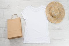 T-shirt mockup, t shirt top view. empty tshirt for logo on wooden floor copy space mock up. Casual clothes background