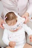 T-shirt over babys head Royalty Free Stock Photos