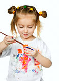T-shirt in the paint. Beautiful little girl with a t-shirt in the paint stock images