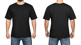 T-shirt preto em um fundo branco, em uma parte dianteira e em uma parte traseira do homem novo fotos de stock royalty free