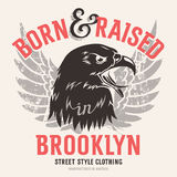 T shirt print 007. Lettering Born and raised in Brooklyn and American eagle head. This illustration can be used as a print on T-shirts and other clothes Royalty Free Stock Image