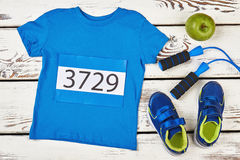 T-shirt, skipping rope and apple. Royalty Free Stock Images