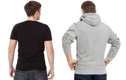 T shirt and sweatshirt template. Men in black tshirt and in grey hoody. Back rear view. Mock up isolated on white background. Copy royalty free stock photography