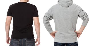 T shirt and sweatshirt template. Men in black tshirt and in grey hoody. Back rear view. Mock up isolated on white background. Copy. Space. Place for print stock image