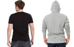 T shirt and sweatshirt template. Men in black tshirt and in grey hoody. Back rear view. Mock up isolated on white background. Copy stock photo