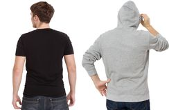 T shirt and sweatshirt template. Men in black tshirt and in grey hoody. Back rear view. Mock up isolated on white background. Copy. Space. Place for print royalty free stock image