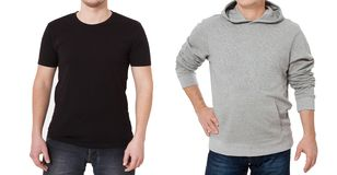 T shirt and sweatshirt template. Men in black tshirt and in grey hoody. Front view. Mock up isolated on white background. Copy stock photo