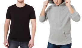 T shirt and sweatshirt template. Men in black tshirt and in grey hoody. Front view. Mock up isolated on white background. Copy. Space. Place for print. Cropped royalty free stock image
