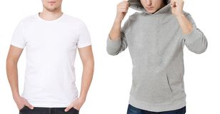 T shirt and sweatshirt template. Men in white tshirt and in grey hoody. Front view. Mock up isolated on white background. Copy. Space. Place for print. Cropped royalty free stock photo