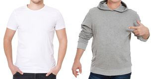 T shirt and sweatshirt template. Men in white tshirt and in grey hoody. Front view. Mock up isolated on white background. Man. Pointing copy space. Place for stock images