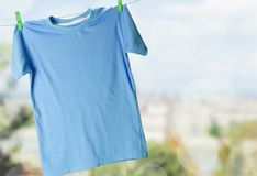 T-shirt. Clothesline shirt green clothing hanging laundry Royalty Free Stock Images