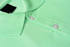 T-shirt verde do polo. Imagem de Stock