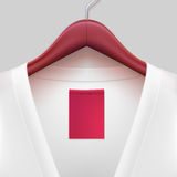 T-shirt With Label Hanging On A Hanger Royalty Free Stock Photo
