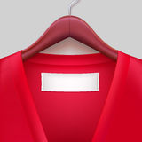 T-shirt With Label Hanging On A Hanger Royalty Free Stock Photography