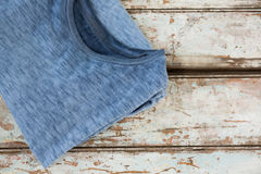 T-shirt on wooden plank Royalty Free Stock Image