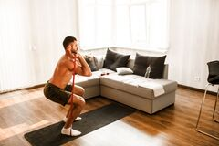 Free T-shirtless Guy Sportsman In Go In For Sport At Home. Young Man Doing Sport Workout In Room During Quarantine. Stand On Stock Photography - 183419542