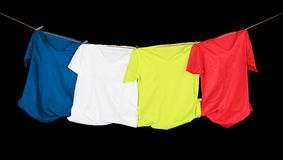 T-shirts. Colorful t-shirts on black Stock Photography