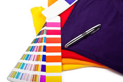 T shirts, color chart and pen. Colorful t shirts, color chart and ballpoint pen Stock Photo