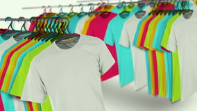 T-shirts. Colorful t-shirts hanging on a rack. stock video footage