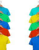 T-shirts on hangers close-up Stock Photos