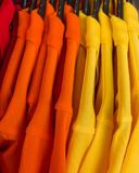 T-shirts on hangers. Royalty Free Stock Photos