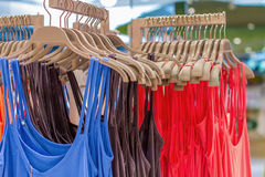 T-shirts hanging on a hanger in the storec Stock Photography