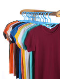 T-shirts hanging on hangers Stock Photography