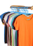 T-shirts hanging on hangers Stock Images