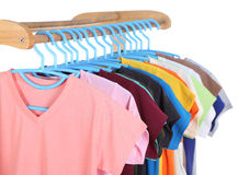 T-shirts hanging on hangers Stock Image