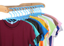 T-shirts hanging on hangers Royalty Free Stock Image