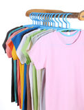 T-shirts hanging on hangers Royalty Free Stock Images