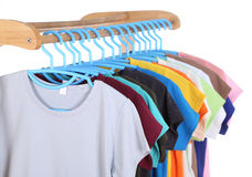 T-shirts hanging on hangers Royalty Free Stock Photo