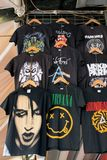 T-shirts printed with rock band designs royalty free stock photos
