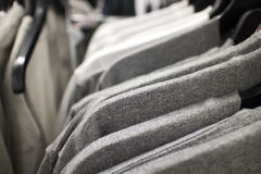 T-shirts on rack at clothing store Royalty Free Stock Photos