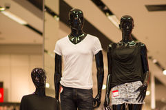 T-shirts and shorts on black mannequins in mall Royalty Free Stock Image