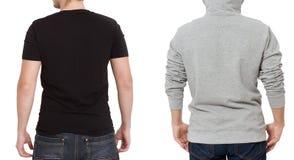 T-skjorta- och tröjamall Män i svart tshirt och i grått hoody Tillbaka bakre sikt Åtlöje som isoleras upp på vit bakgrund kopia fotografering för bildbyråer