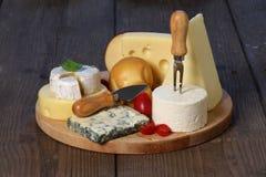 T-sorter av ost arkivbild