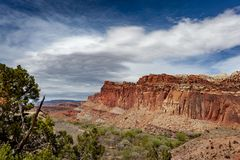 Capitol Reef National Park is in Utah`s southern desert. T surrounds a long wrinkle in the earth known as the Waterpocket Fold, with layers of golden sandstone royalty free stock photo