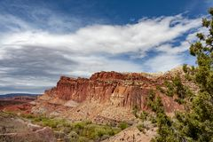 Capitol Reef National Park is in Utah`s southern desert. T surrounds a long wrinkle in the earth known as the Waterpocket Fold, with layers of golden sandstone stock photography