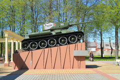 The T-34 tank on a high pedestal, a memorial complex on a mass grave of the Soviet soldiers. SOVETSK, KALININGRAD REGION, RUSSIA - MAY 5, 2016: The T-34 tank on Royalty Free Stock Photos