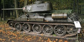 T34-85 tank outdoors on display. Photograph shows a side view of a T34-85 tank in dark green colours clearly showing fuel tank, tracks and turret Royalty Free Stock Photography